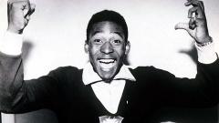 Pelé comemora depois da conquista do primeiro título mundial do Brasil em 1958