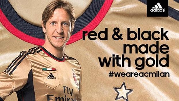 Ambrosini posou com a nova camisa do dourada do Milan, que estreia no próximo domingo, contra a Roma