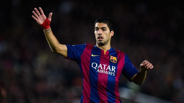 Suárez diz estar feliz na sombra de Messi - e está rritado com acusações na Inglaterra